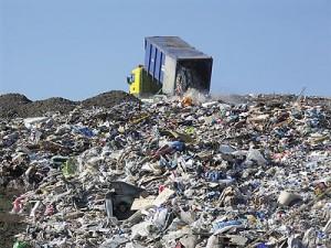 Dumping trash in a landfill